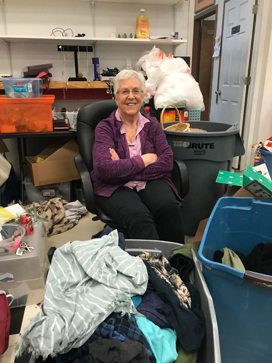 Fabulously Frugal Thrift Shop's manager Shirley Mock sits among bins and boxes of donations the store hasn't sorted yet on Monday, Jan. 20.